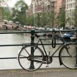 Bike parked on a bridge — Stock Photo #8849672