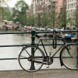 Bike parked on bridge — Stock Photo #8849672