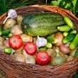Fresh vegetables mix in a wicker basket — Stock Photo