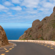 Road between mountains leading to the sea — Stock Photo