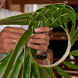 Palm leaves hat preparation - Stock Photo