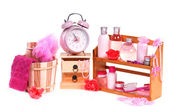 Shelf full of different spa accessories and alarm clock isolated on white b — Stock Photo