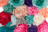 A field of artificial flowers (ladies barrettes with flowers) — Stock Photo