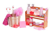A lot of different spa accessories and two valentine hearts inside wooden b — Stock Photo
