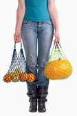 Woman with two fruit grocery bags — Stok fotoğraf