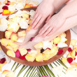 Pedicure and manicure spa with petals and flowers — Stock Photo