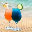 Exotic fruit cocktails at the sandy beach — Stock Photo