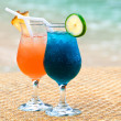 Royalty-Free Stock Photo: Exotic fruit cocktails at the sandy beach