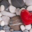 Red heart among pebble stones — Stock Photo #9308002