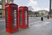 Traditional old style red phone booths — Stock Photo
