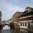 River with Traditional Half-Timbered Houses at the both banks, France - Stock Photo
