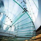 Modern glass spiral staircase — Stock Photo