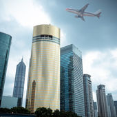 Modern building with airplane — Stock Photo