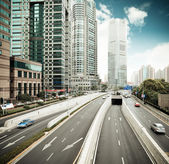 Traffic in shanghai financial center district — Stock Photo