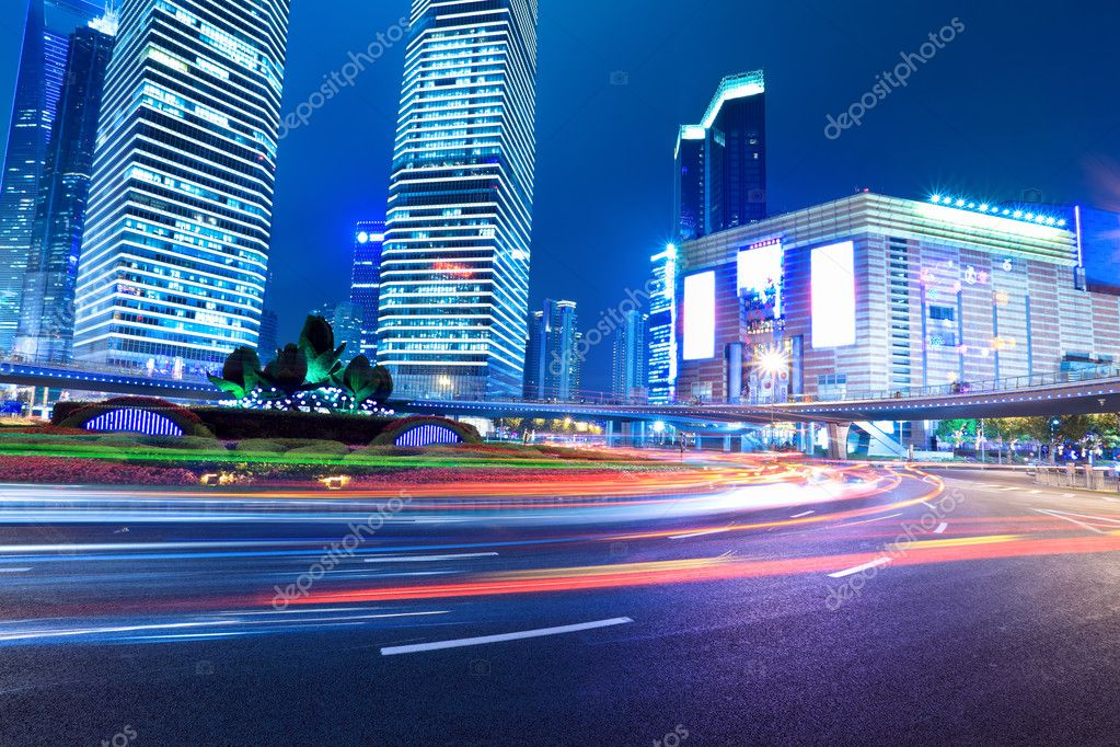 Light trails on the modern city in shanghai at night — Stock Photo #10724077