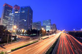 Beijing cityscape at dusk with traffic — Stock Photo