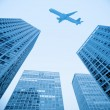 Foto Stock: Airplane and modern building