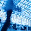 Passenger motion blur in airport - Stock Photo