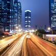 Light trails on shanghai financial center at night — Stock Photo