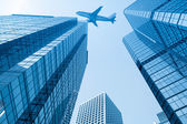 Airplane with modern building — Stock Photo