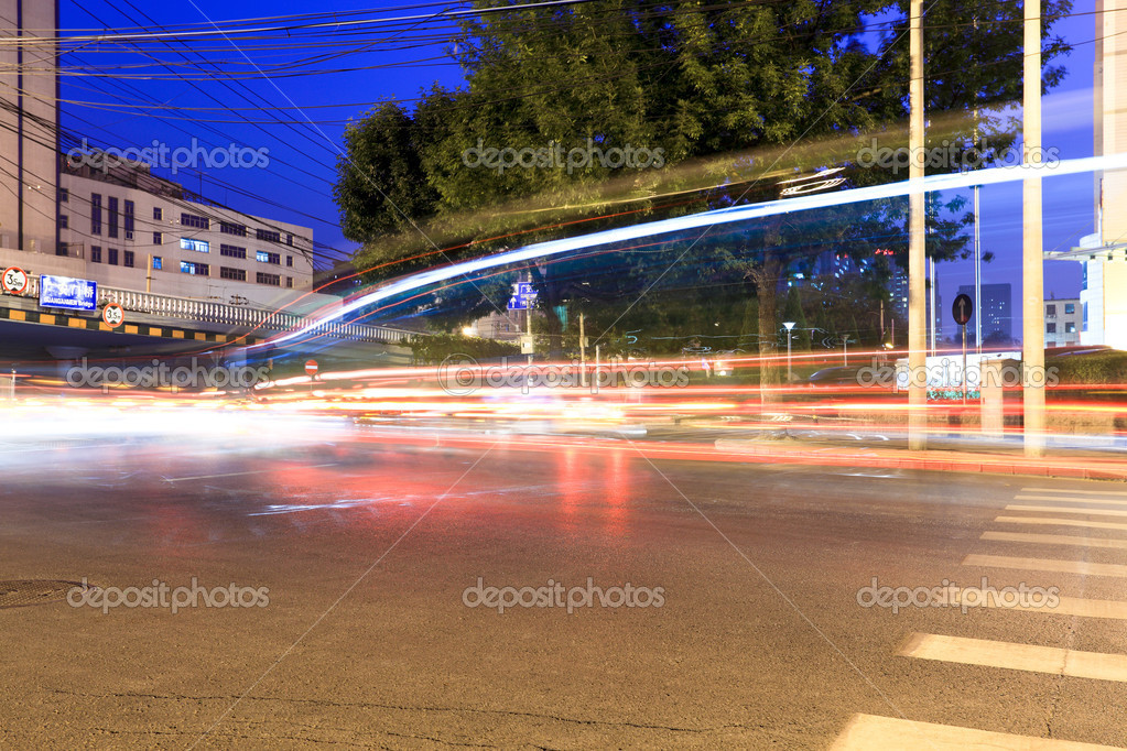 Light trails on the street at night in beijing  Stock Photo #8756516