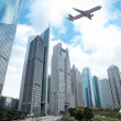 Shanghai financial district and airplane — Stock Photo #9120371