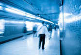 Passengers walking in underpass — Stock Photo