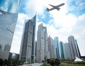 Shanghai financial district and airplane — Stock Photo