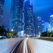 Tunnel and modern building in shanghai at night — Stock Photo