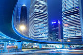 Light trails on shanghai downtown at night — Stock Photo