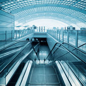 Escalator in modern airport hall — Stock Photo