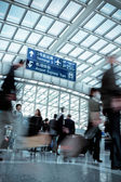 Moving blur in modern airport hall — Stock Photo