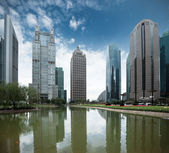 Pond and modern building in shanghai — Stock Photo