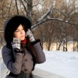 Portrait of a girl walking in park in winter - Stok fotoğraf