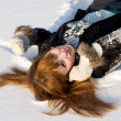 Royalty-Free Stock Photo: Portrait of a girl lying on snow