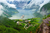 Mountain lake with ship — Stock Photo