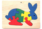 Colorful wooden puzzle in shape of rabbit — Stock Photo