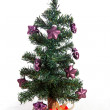 Plastic christmas tree with purple stars — Stock Photo