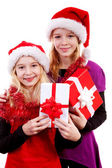 Two girl with christmas hat and presents — Stock Photo