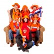 Group of Dutch soccer fan watching game — Stock Photo #8140612