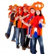 Group of Dutch soccer fans in polonaise — Stock Photo