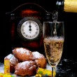 Stock Photo: Traditional New Year's eve food and clock on midnight