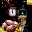 Traditional New Year's eve food and clock on midnight — Stock Photo