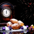 Dutch oliebollen and clock on midnight — Stock Photo