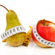 Healthy diet pear and apple with measure tape — Stock Photo
