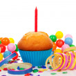 Royalty-Free Stock Photo: Birthday cupcake with candle, party streamers and colorful confe