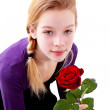 Young girl with red rose — Stock Photo