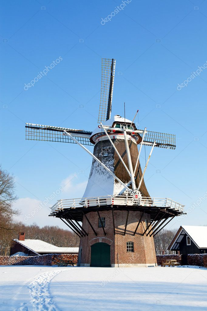Dutch windmill near Apple in the snow — Stock Photo #8993101