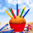 Cupcake with lots of candles and colorful confetti — Stock Photo #9457004