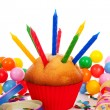 Cupcake with lots of candles and colorful confetti — Stock Photo